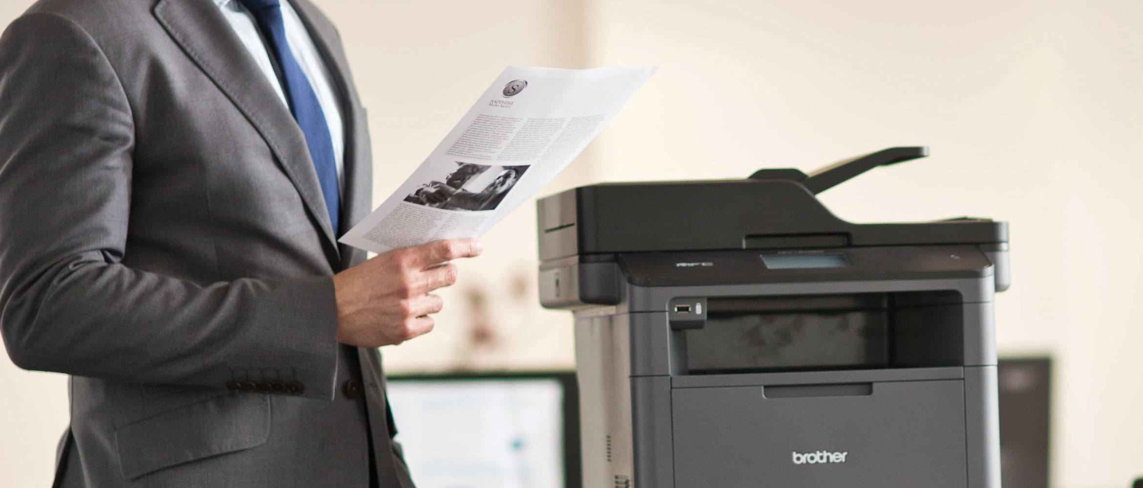 Man with the Brother printer MFC-L5700DN